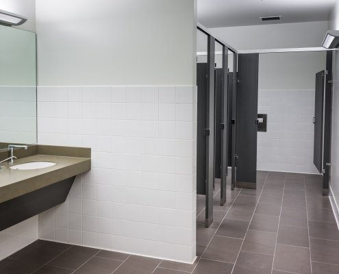 Commercial women's bathroom in neutral colors